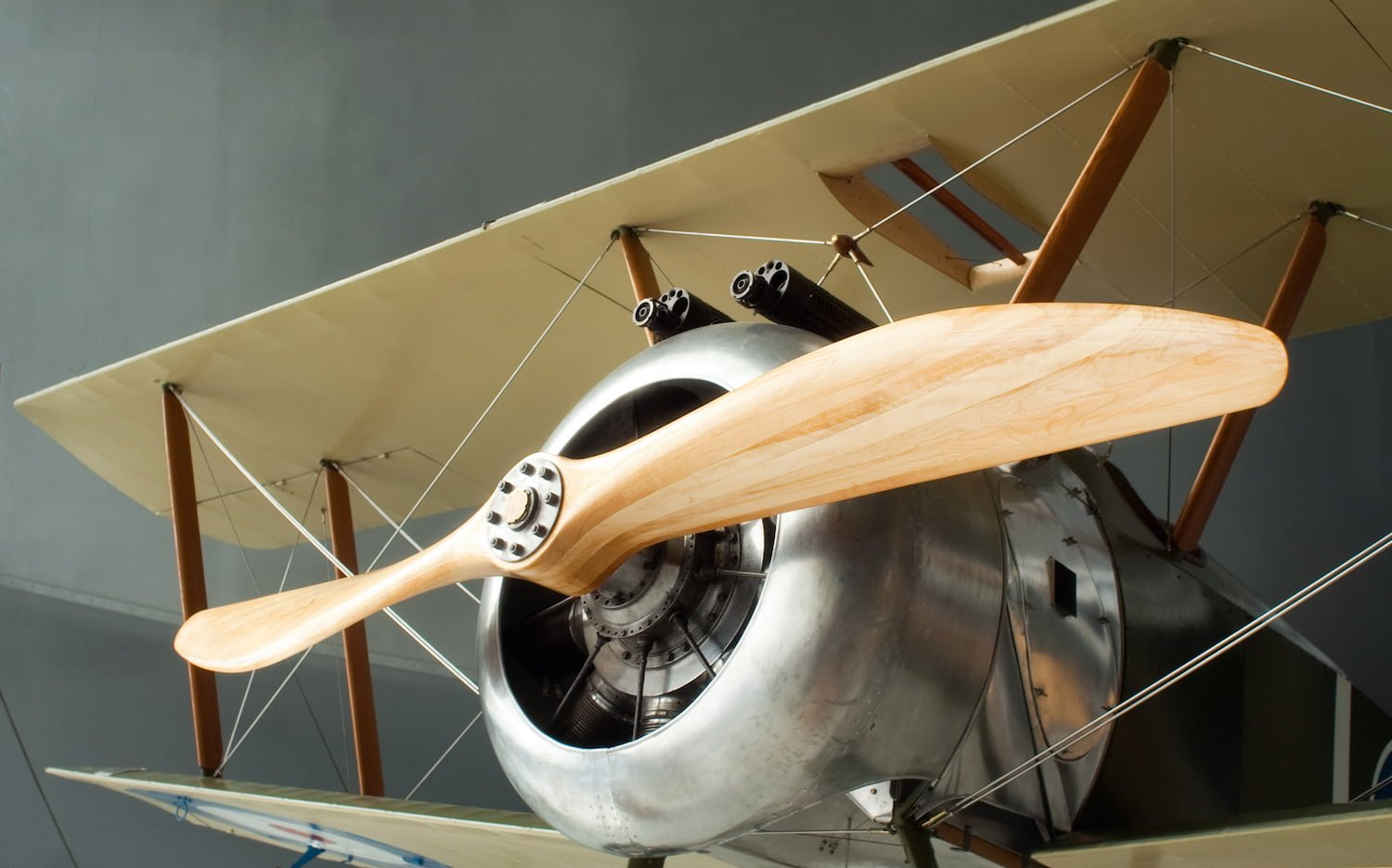 Model of classic plane in a museum.