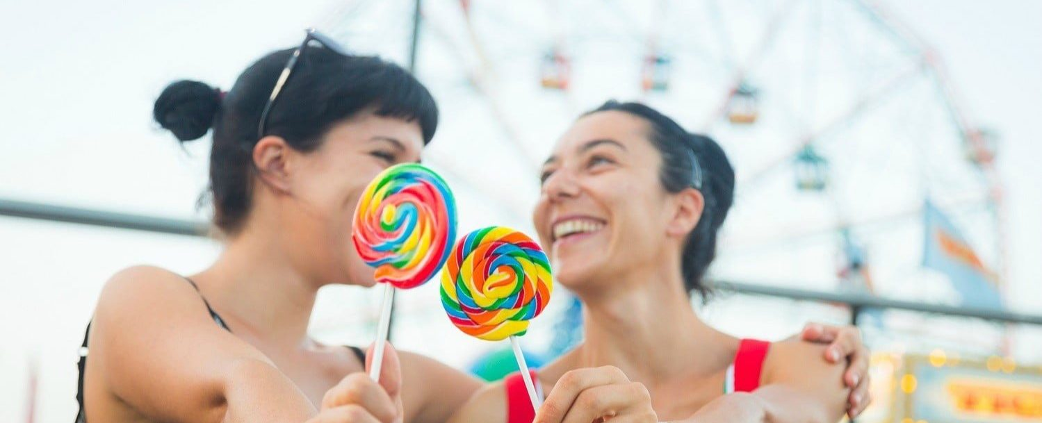 Happy Young Women eating Lollipop